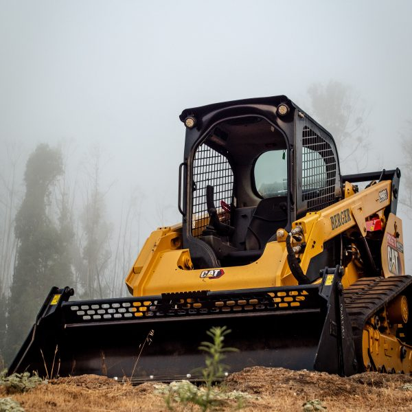 yellow and black heavy equipment on brown grass field
